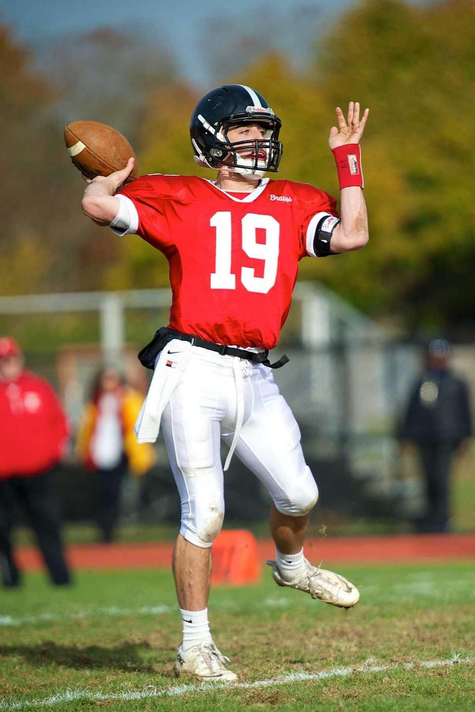 Syosset quarterback Hunter Gross attempts a pass against