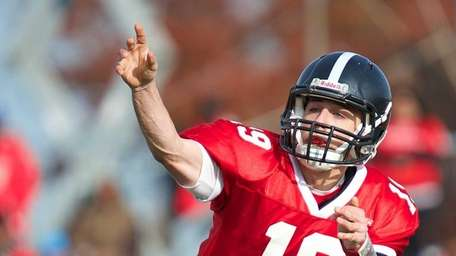 Syosset quarterback Hunter Gross attempts a pass against