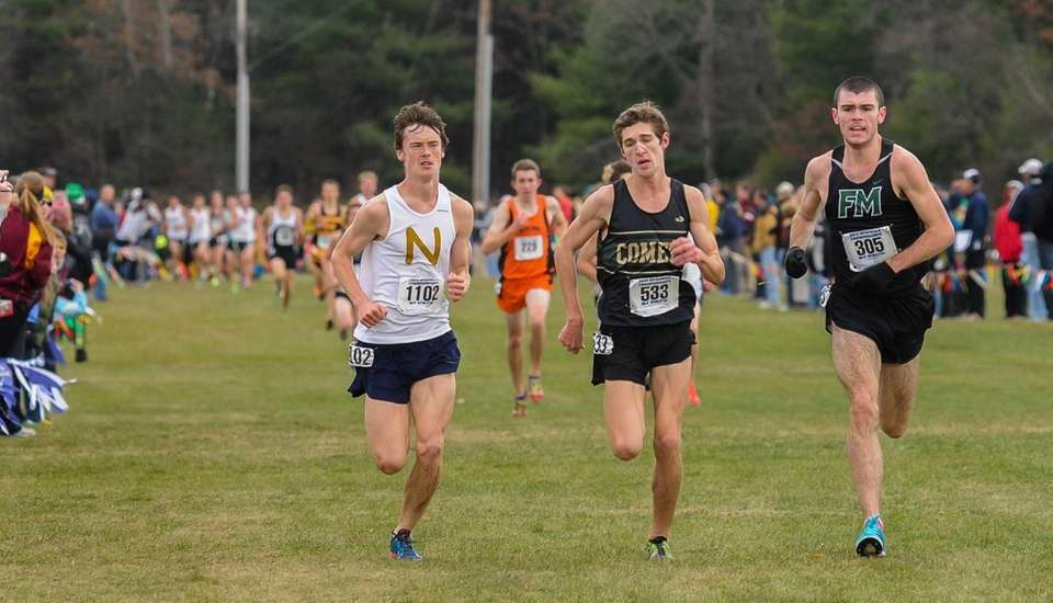 Mike Brannigan (left) races for Northport at the
