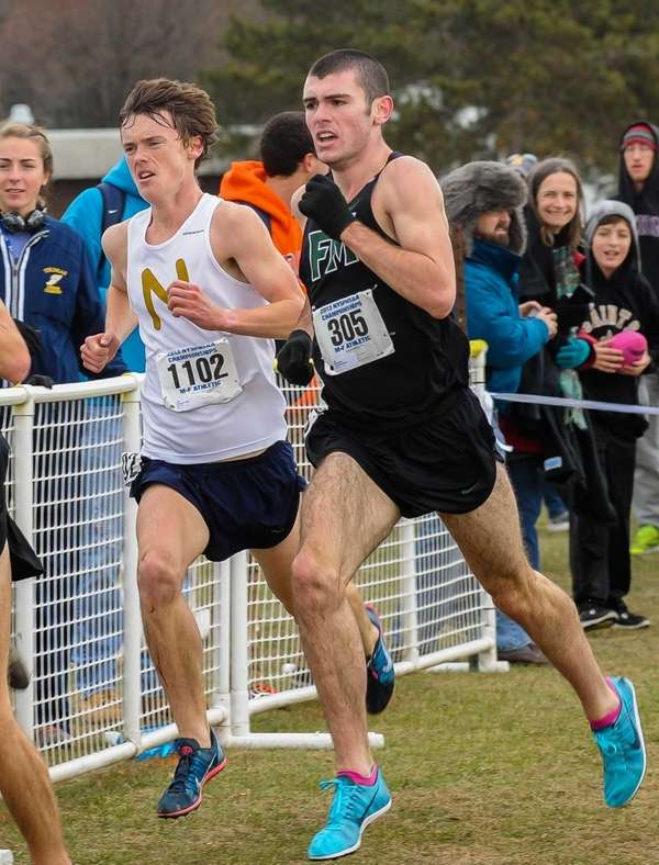 Mike Brannigan, left, of Northport, races against Bryce
