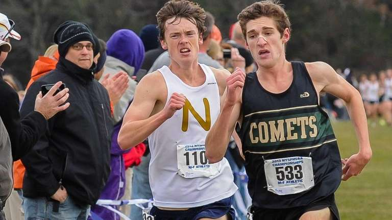 Mike Brannigan (left) races for Northport against Mickey