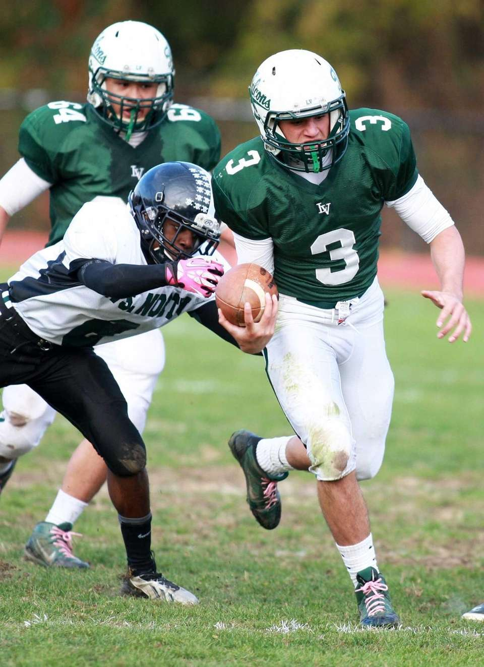 Locust Valley quarterback Jordan Formicola (no. 3) tries