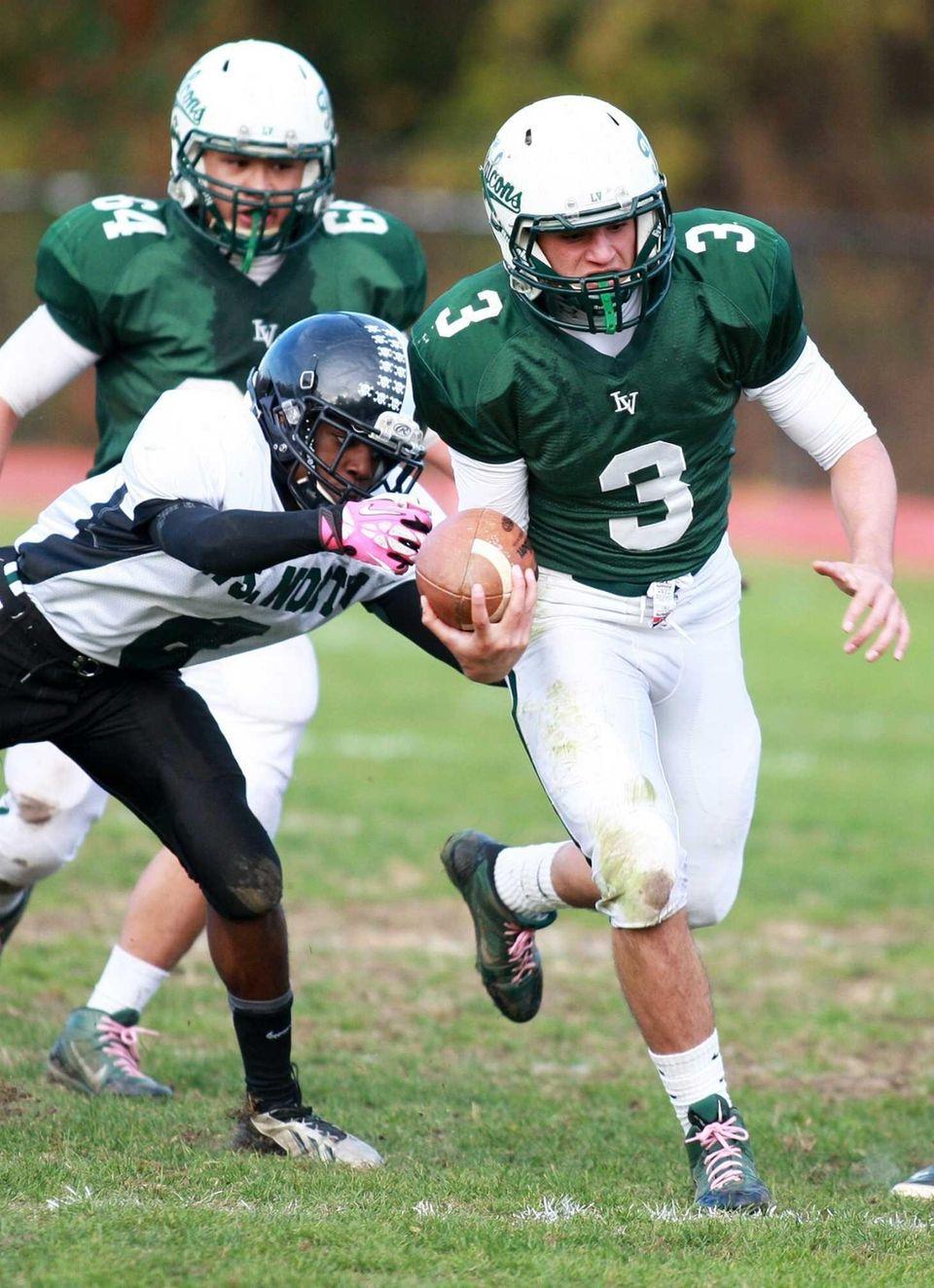 Locust Valley quarterback Jordan Formicola (no. 3) tries
