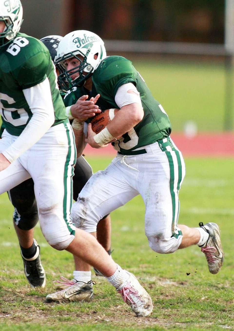 Locust Valley fullback Matt Vezza (no. 38) rushes