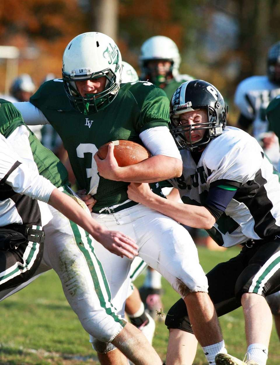 Locust Valley quarterback Jordan Formicola (no. 3) rushes