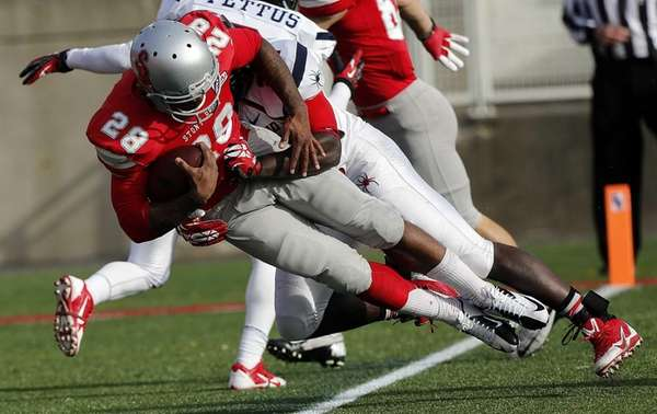 Stony Brook Seawolves running back James Kenner falls