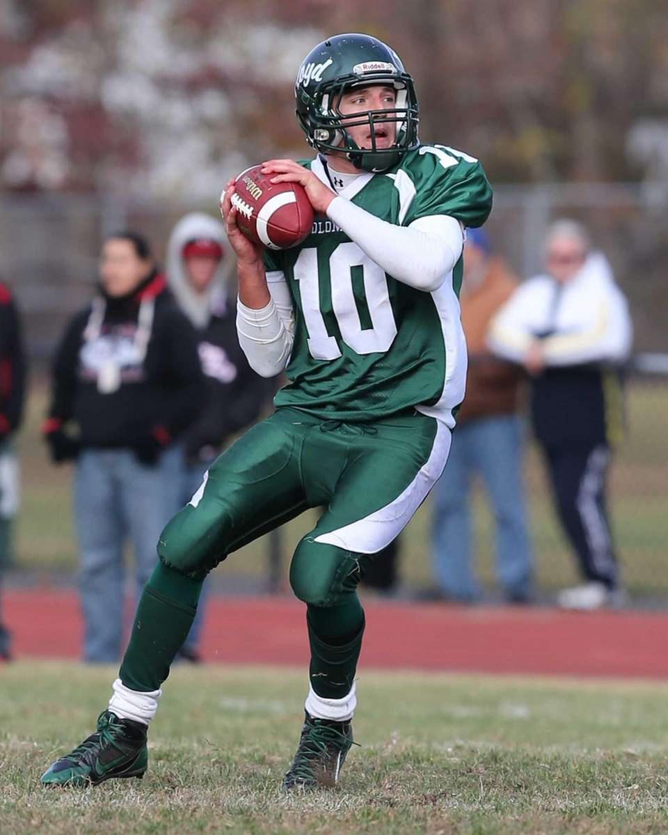 William Floyd quarterback Eric Brust drops back to