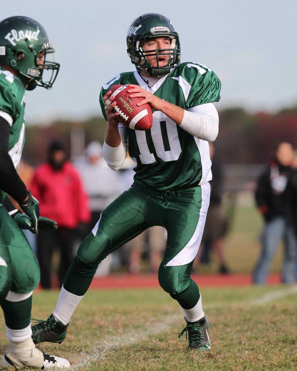William Floyd quarterback Eric Brust drops back to