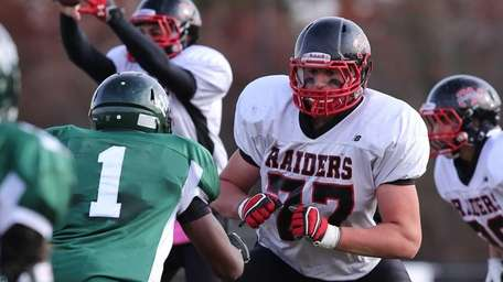 Patchogue-Medford offensive lineman Sean Christie (77) looks to