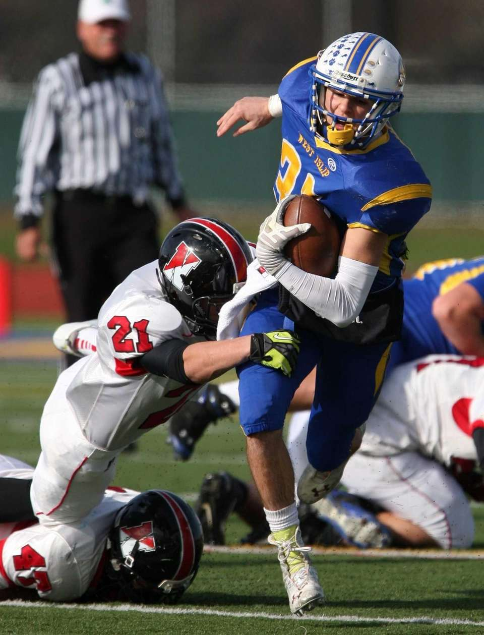 Matt McKeon of West Islip gets brought down