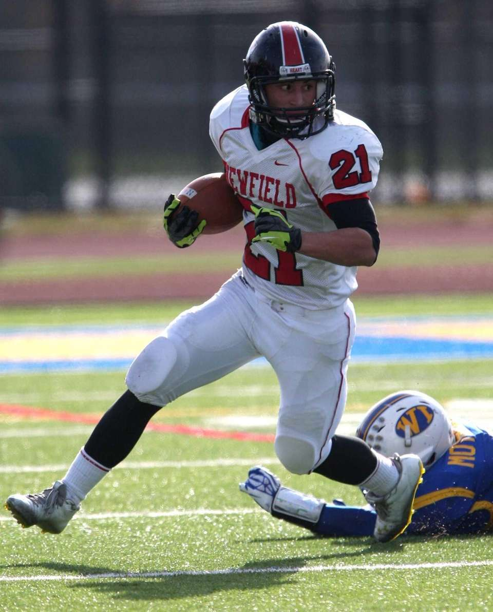 Newfield's Joe Feliciano gains some yardage during a
