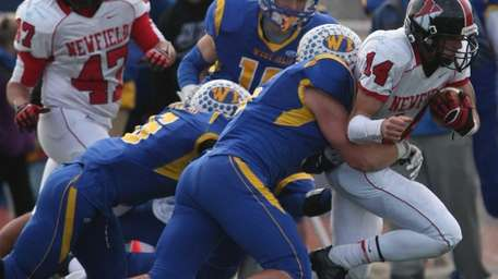 Newfield's Dylan Harned gains some yards and in