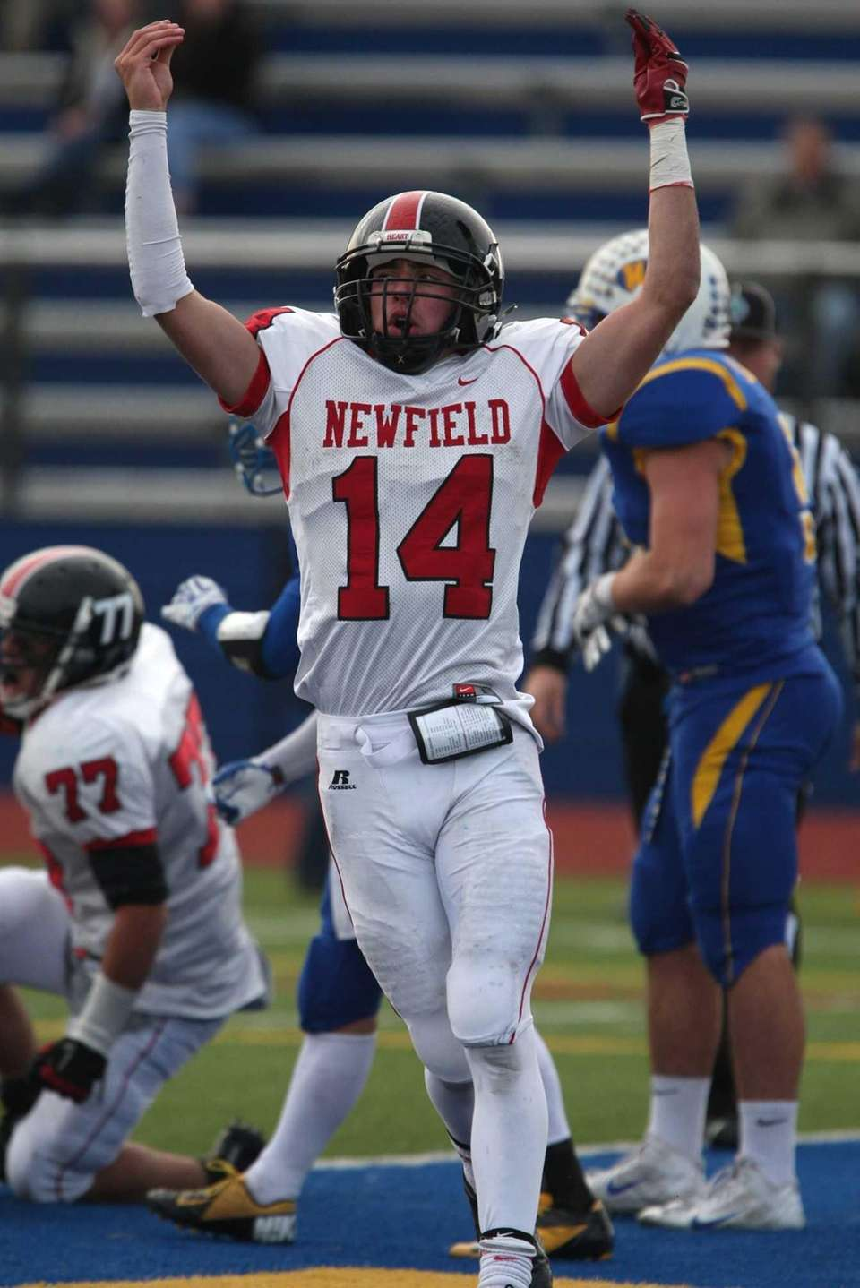 Newfield's Dylan Harned raises his arms after fighting