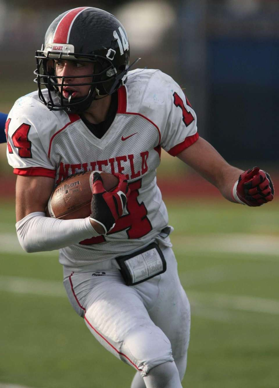 Dylan Harned of Newfield carries the ball during