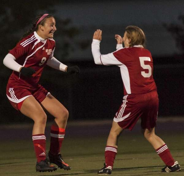 Center Moriches' Casey Luongo, right, celebrates with teammate
