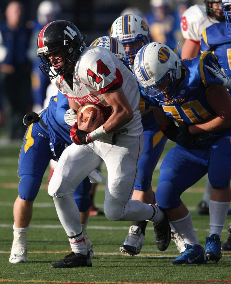 Dylan Harned of Newfield carries the ball and