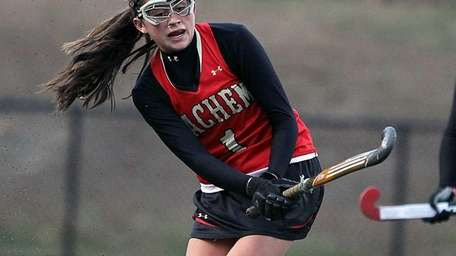 Sachem East's Katie Trombetta clears during the New
