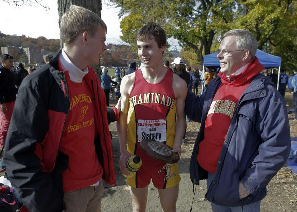 Thomas Slattery of Chaminade High School, center, talks