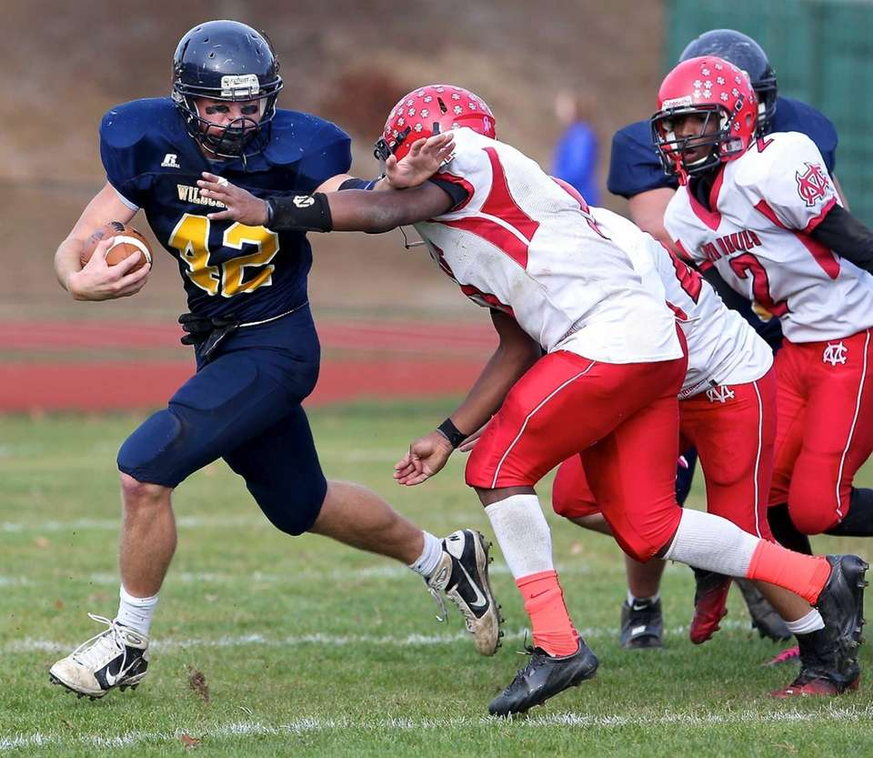 Shoreham-Wading River running back Tyler Anderson tries to