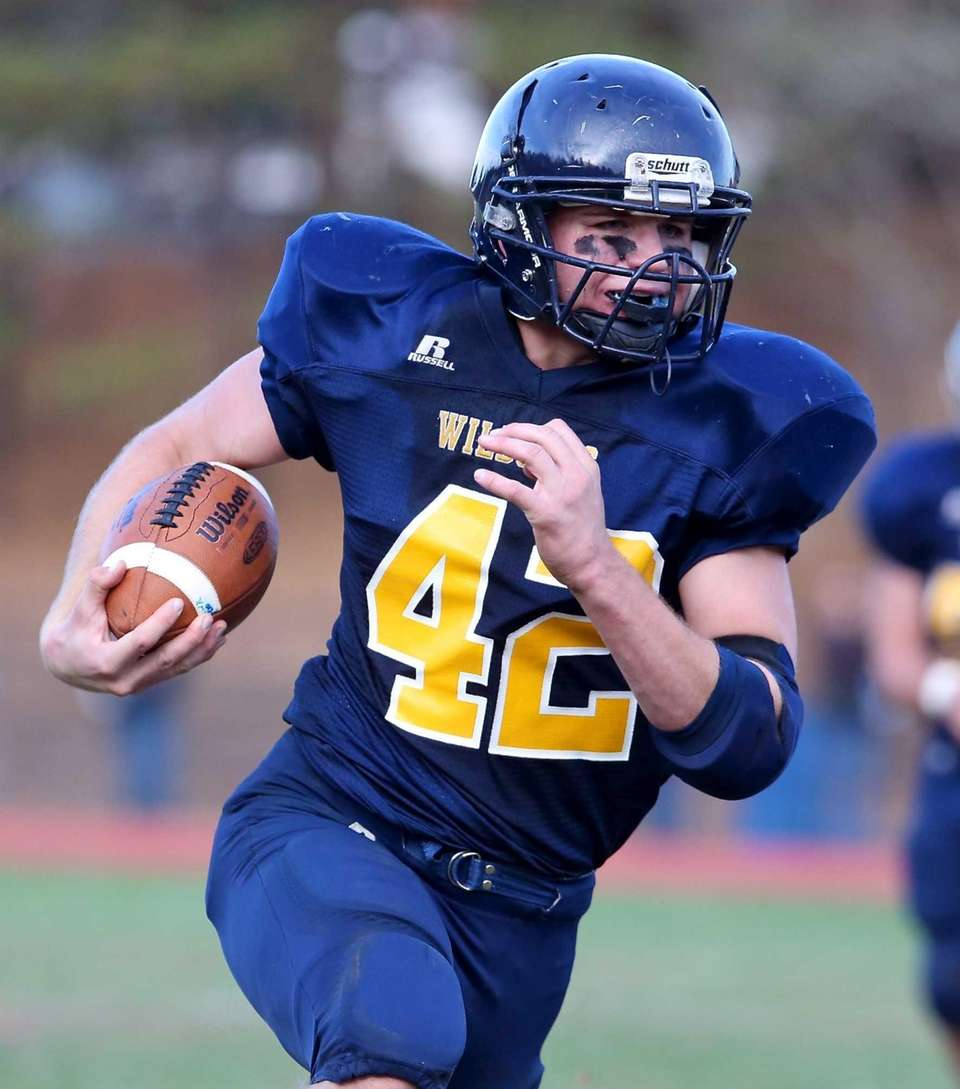 Shoreham-Wading River running back Tyler Anderson rushes against
