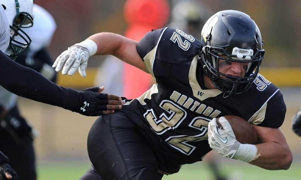 Wantagh running back Peter Brasile fights for yards