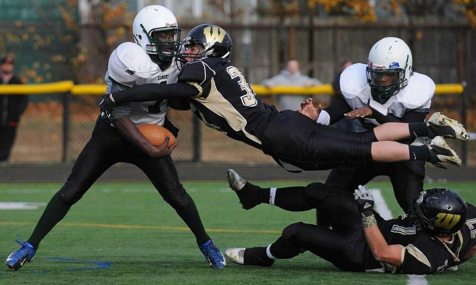 Wantagh's Chris Burke lunges at Elmont quarterback Simon