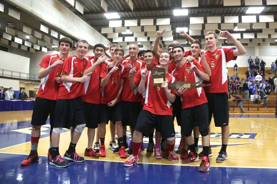 Sachem East's boys volleyball team celebrates after defeating