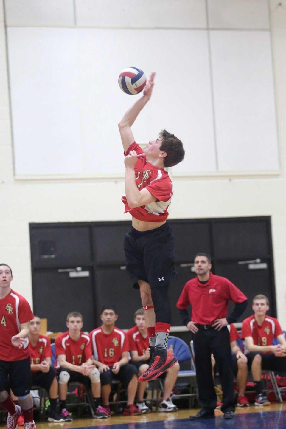 Sachem East's Steve Rodriguez strikes the ball against