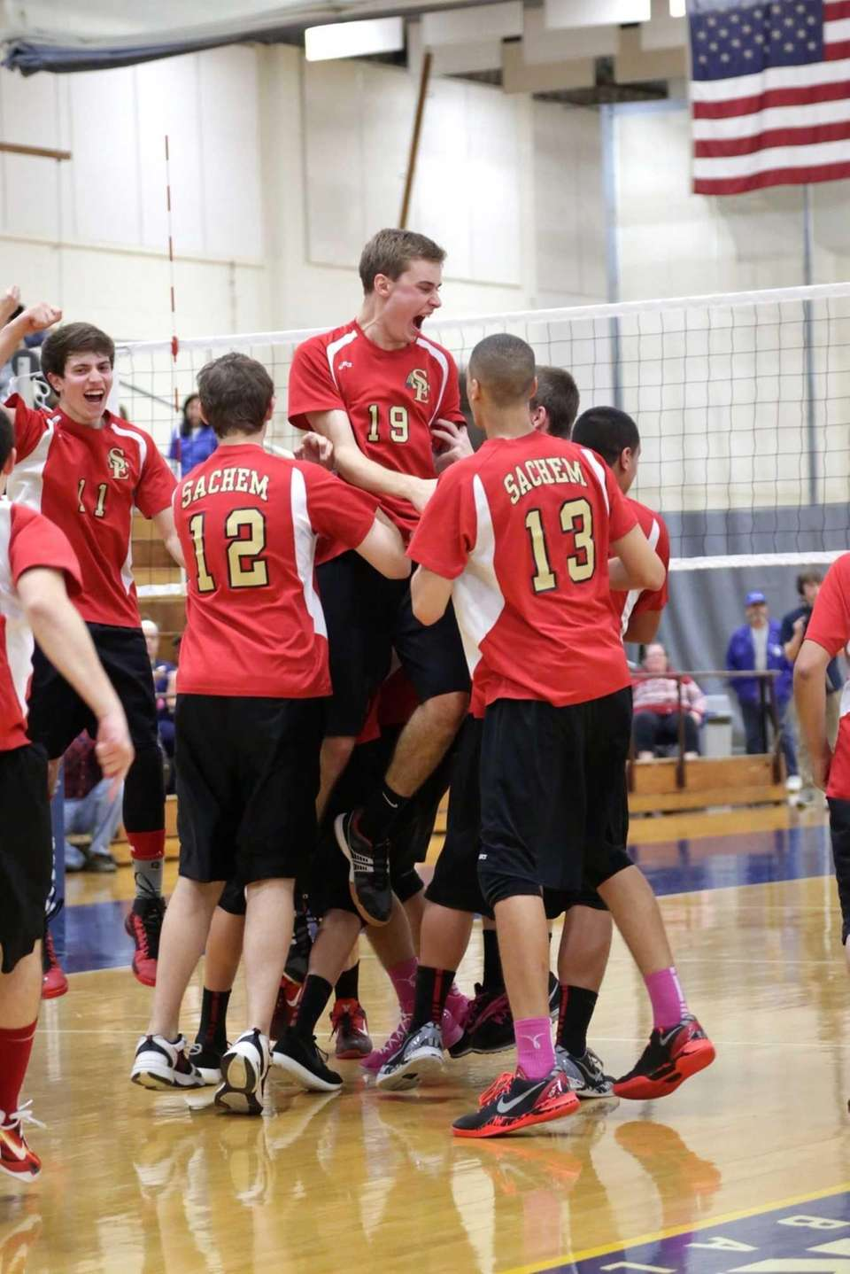 Tom Mitchell of Sachem East celebrates with teammates