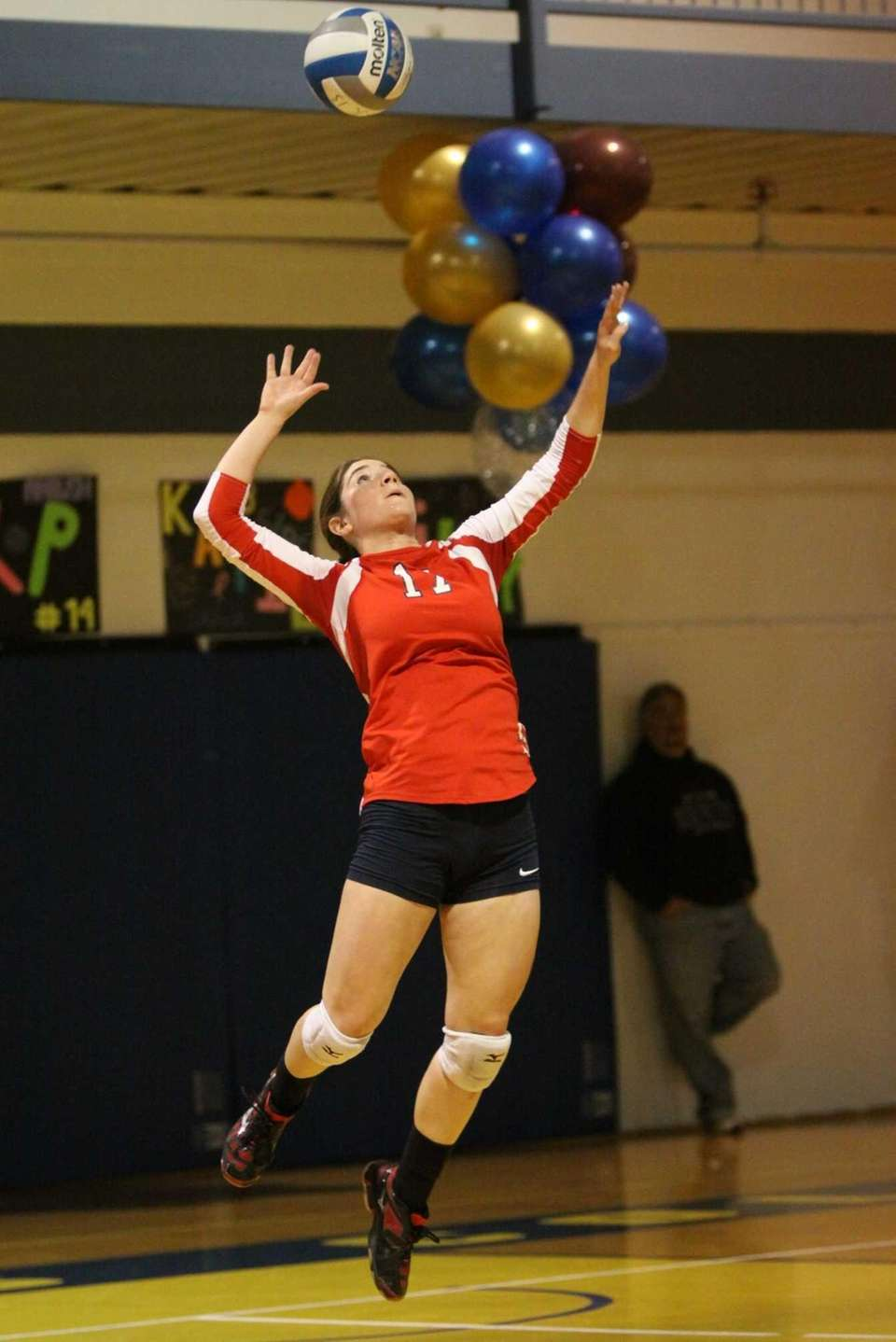 Smithtown East's Dani Nizich serves against Massapequa during