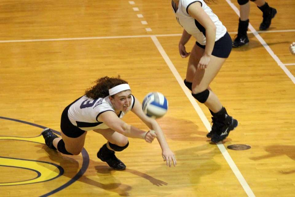 Massapequa's Katie Vedilago dives to save a ball