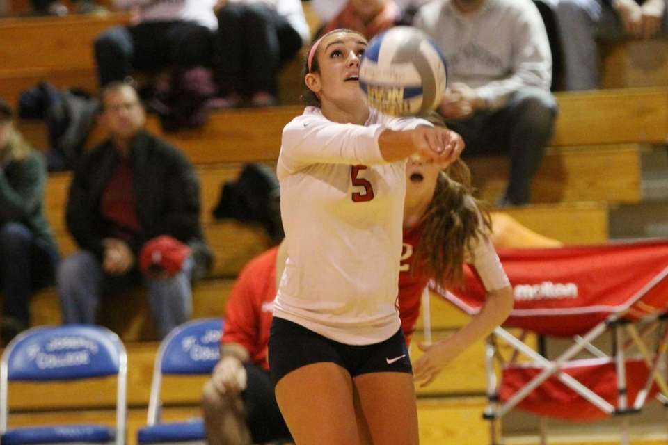 Smithtown East's Ashley Ruggiero bumps the ball against