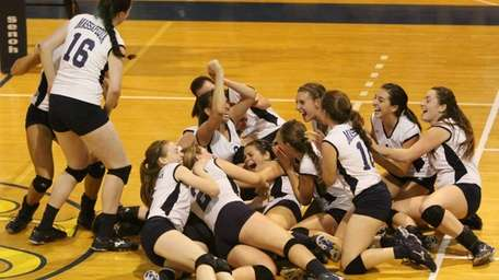 Massapequa celebrates their victory over Smithtown East during