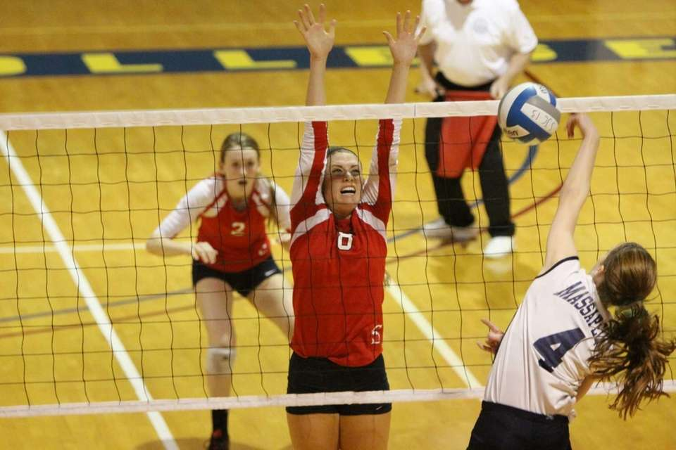 Smithtown East's Laura Pugliese, left, defends against a