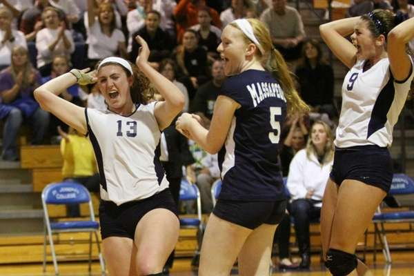 Massapequa celebrates a point against Smithtown East during