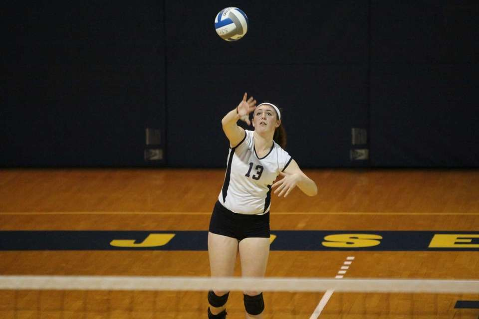 Massapequa's Katie Vedilago serves against Smithtown East during