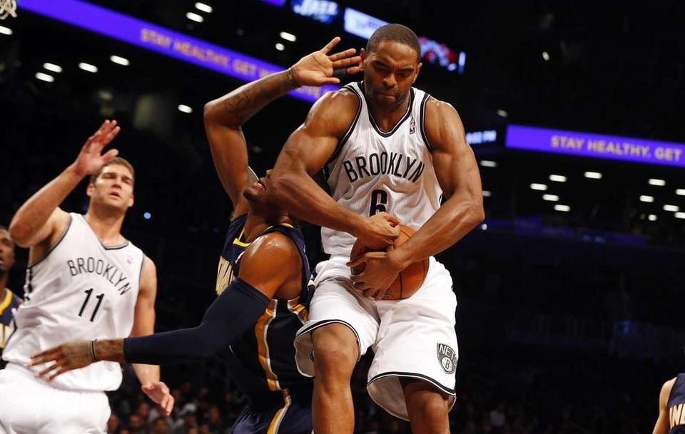 Alan Anderson of the Nets blocks a first-quarter