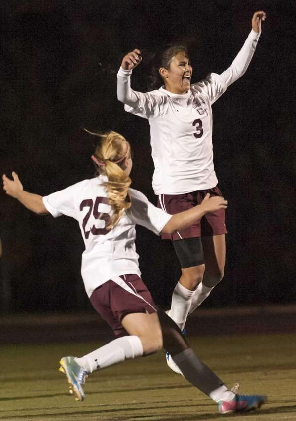 Garden City's Lauren Miesemer, rear, jumps for joy