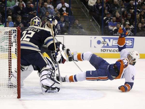 Islanders left wing Michael Grabner falls after being