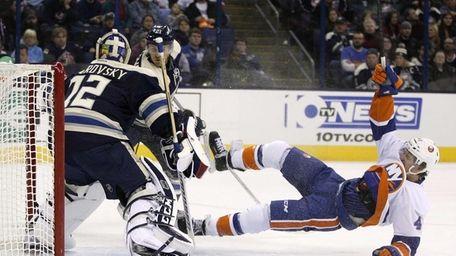 Islanders left wing Michael Grabner falls after being