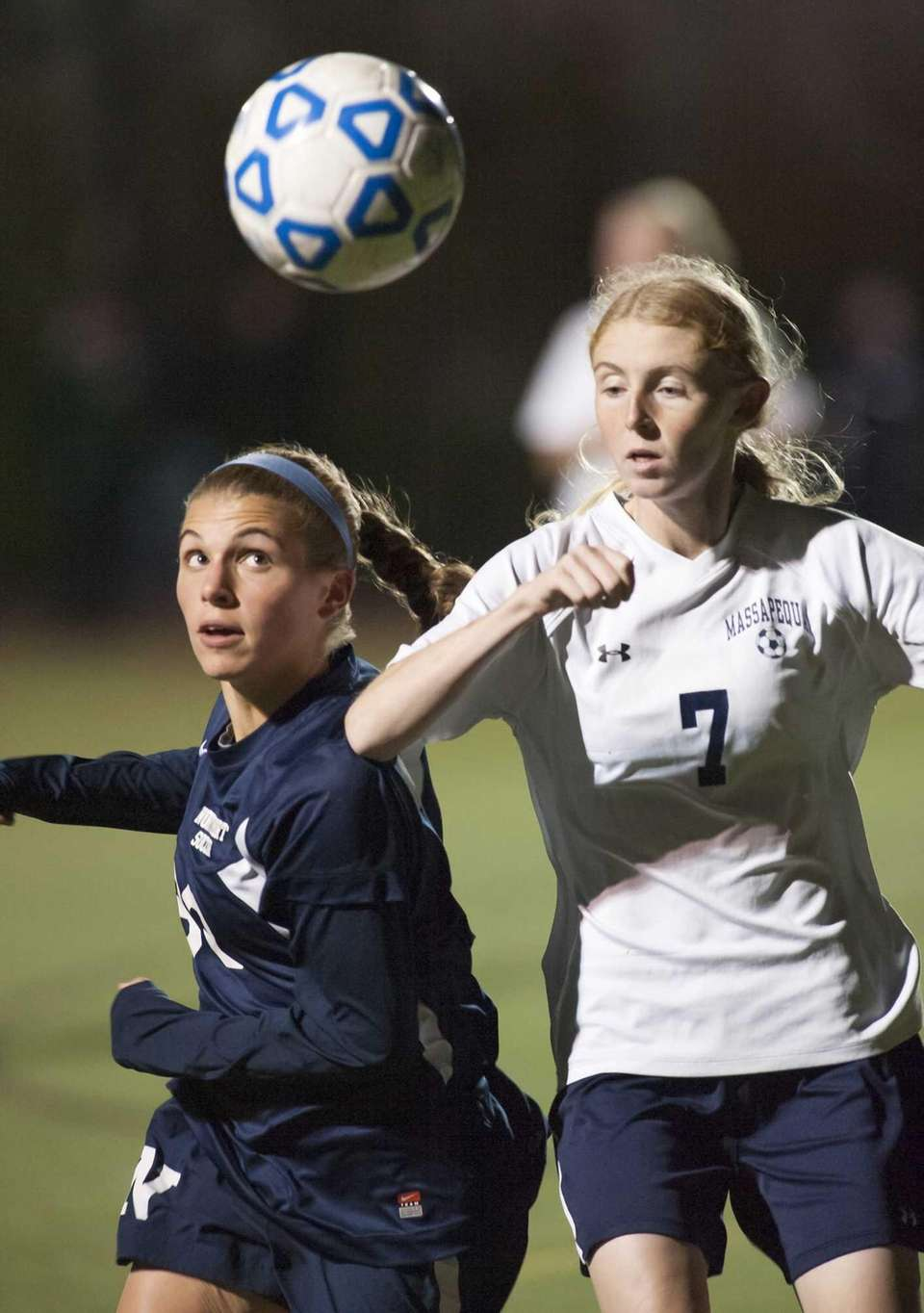 Northport's Cybele Laisney (30, left) keeps her eye