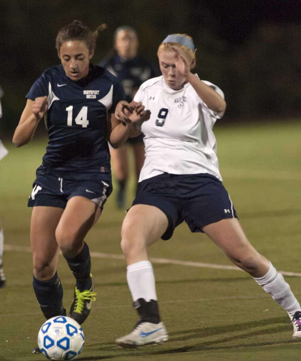 Northport's Vincenza Patrone (14, left) fights for the