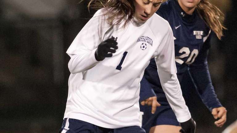 Northport's Sam Avallone (20, right rear) tries to