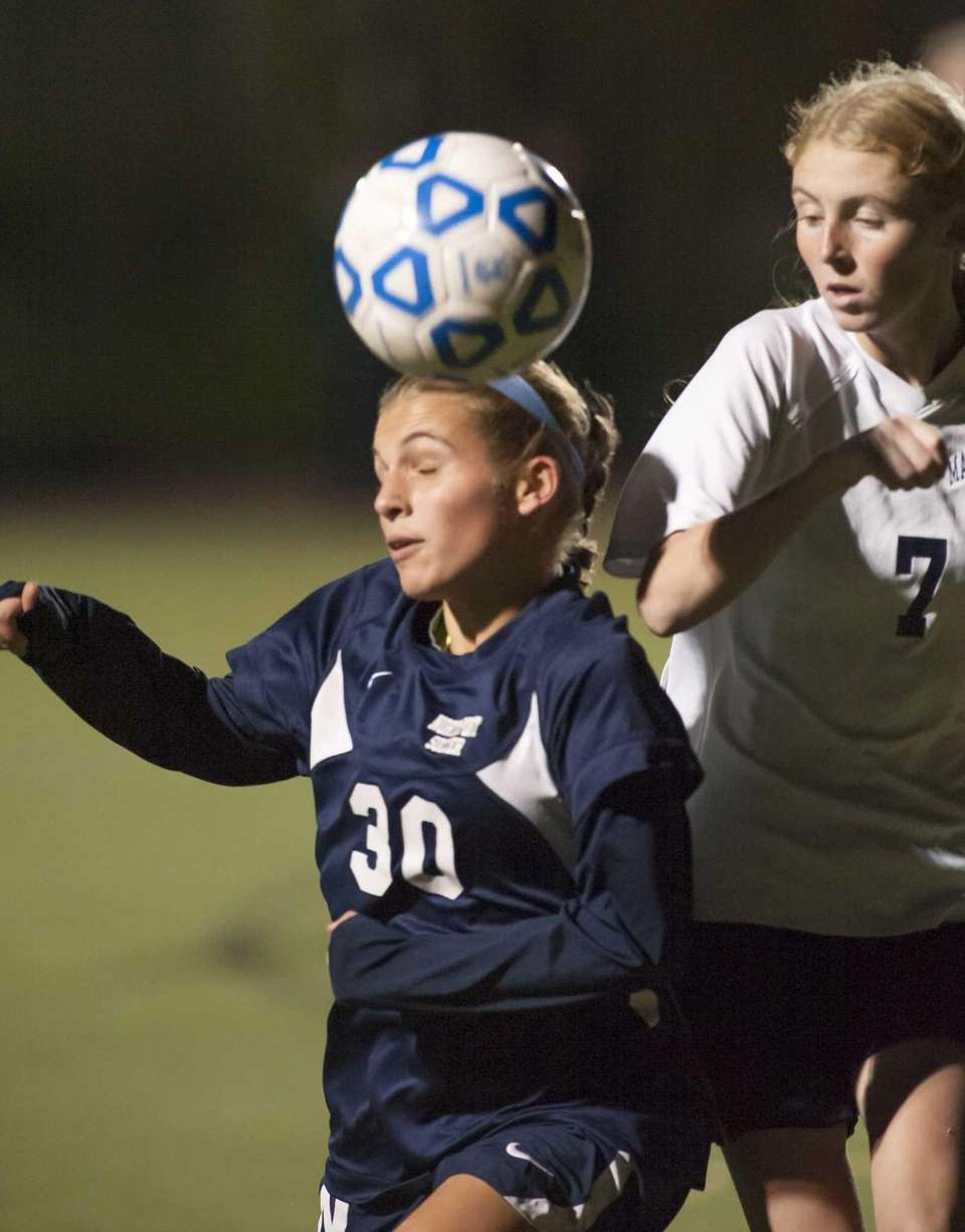 Northport's Cybele Laisney (30, left) goes after the
