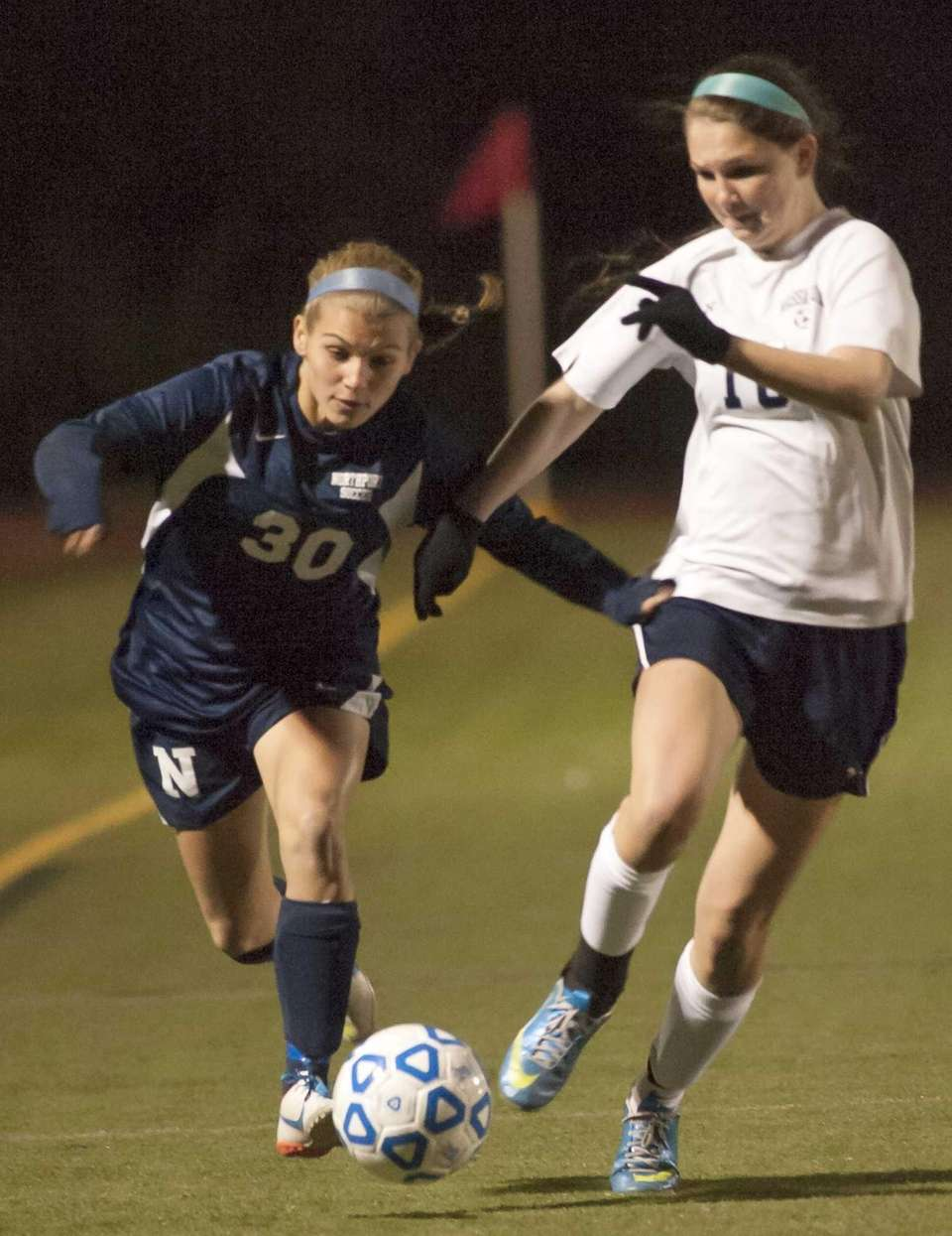 Northport's Cybele Laisney (30, left) chases down a