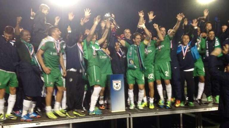 The Cosmos celebrate their win in the the