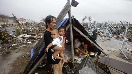 A Filipino father and his children wait for