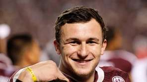 Johnny Manziel of the Texas A&M Aggies waits