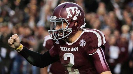 Texas A&M quarterback Johnny Manziel celebrates a touchdown