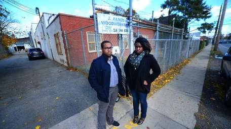 Roosevelt residents Jacob Dixon and Sharisse Carter stand